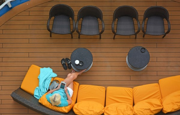 Someone using a phone on a cruise ship deck