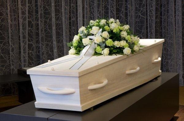 White coffin with flowers