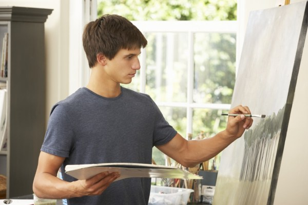 Young man painting