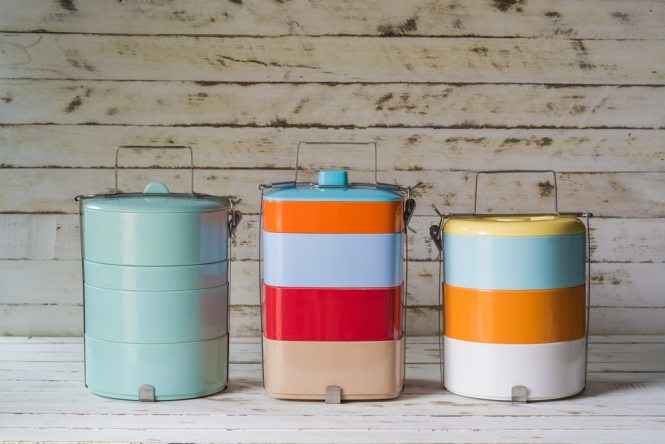 Three brightly coloured tiffin lunch boxes