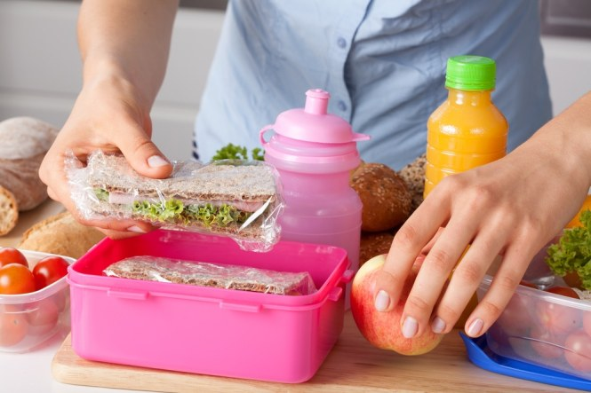 Woman preparing lunch box
