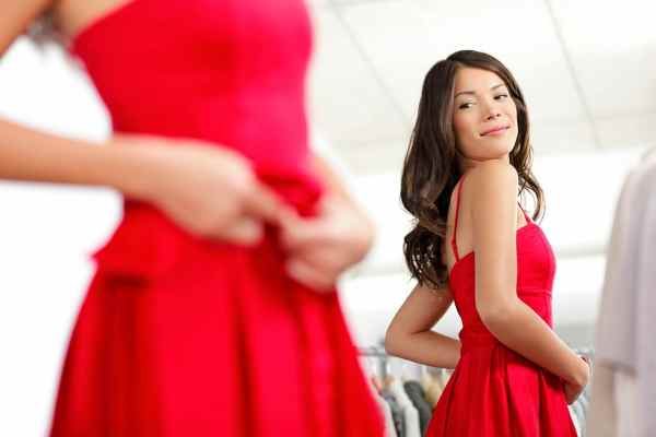 Woman trying on a new red dress