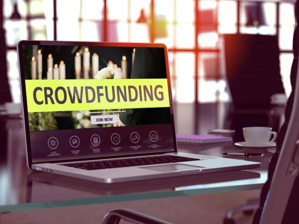 Crowdfunding website on a laptop