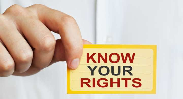 "Someone holding a ""know your rights"" label"