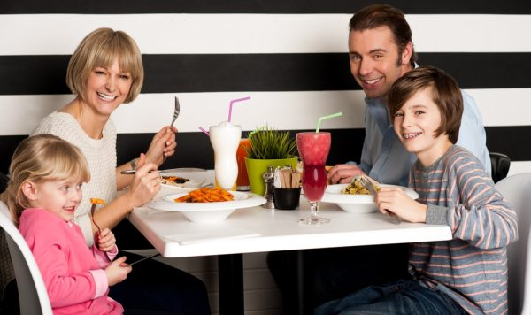 Happy family having a meal in a restaurant