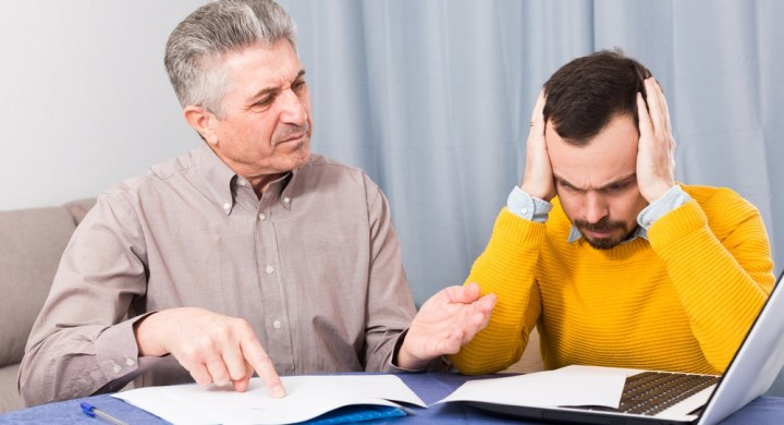 Father explaining a repayment plan to reluctant son