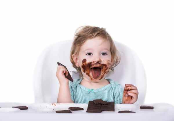 Toddler with chocolate all over their face