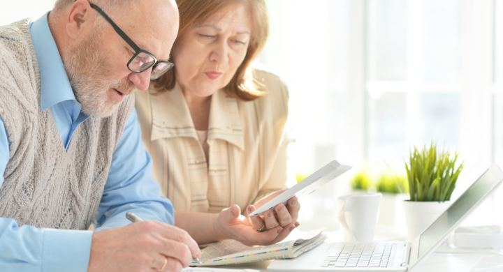 Senior couple doing finances on a laptop