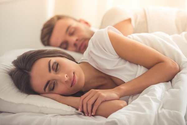 Couple sleeping comfortably