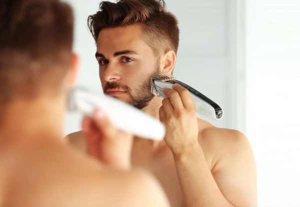 Man using electric beard trimmer
