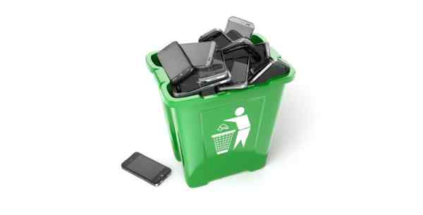 Green recycling bin full of mobile phones