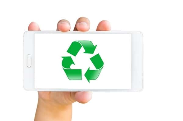 Mobile smartphone with a recycling symbol on the screen