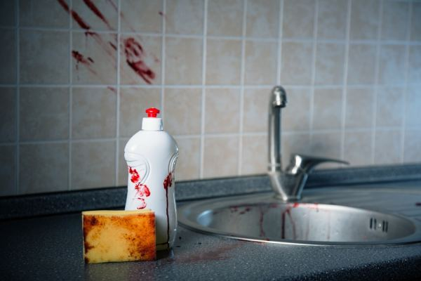 Crime scene with bloody sponge and washing up liquid
