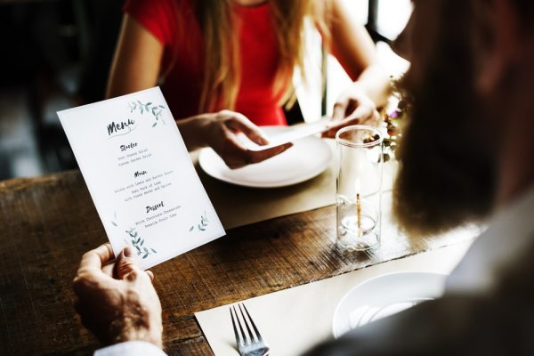 Couple in restaurant looking at menu
