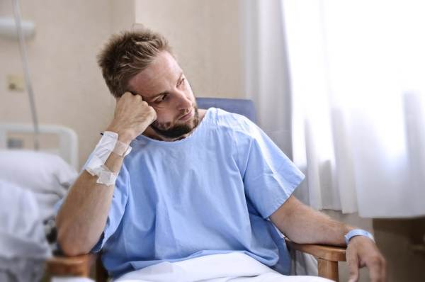 Unhappy man such in hospital