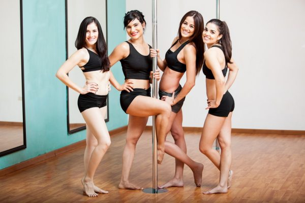 Group at pole dance fitness studio