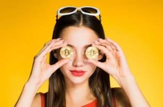 Woman holding bitcoins
