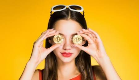 Woman holding bitcoins