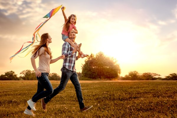 Happy family flying a kite