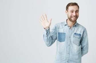 Cheerful man waving politely