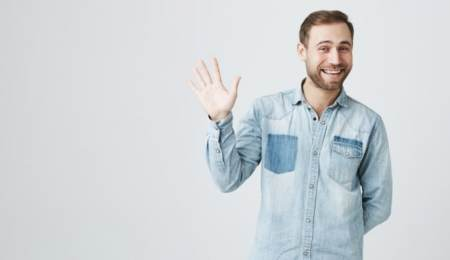 Cheerful man waving politely