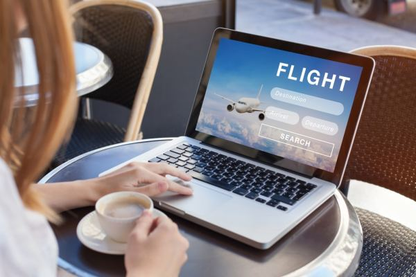 Woman booking flights online