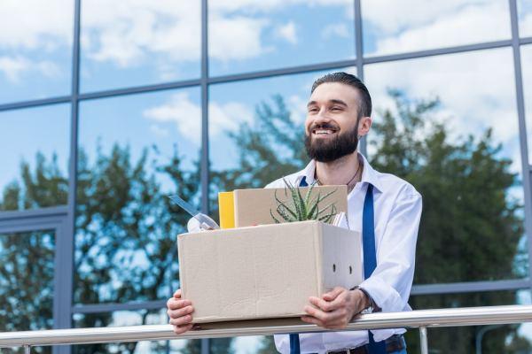 Happy man leaving job