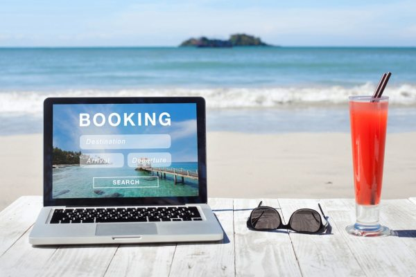 Holiday booking website on laptop