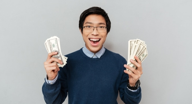 Male Student holding money