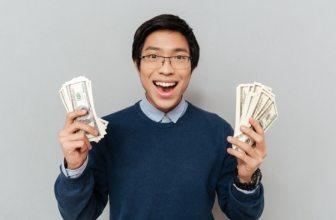 Male Student holding money