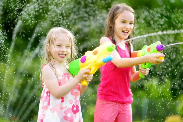 Little girls with water guns