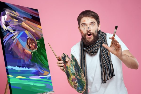 Artist with painting of football player