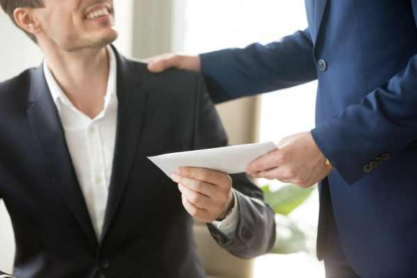 Man receiving pay cheque