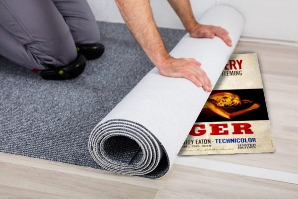 Old film poster under carpet