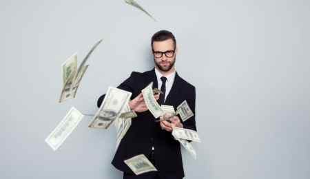 Businessman making it rain money