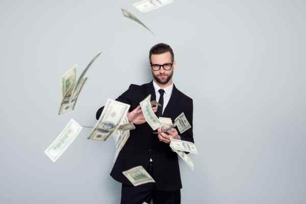 Businessman making it rain money