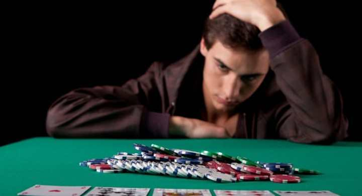 Man at casino table with gambling addiction