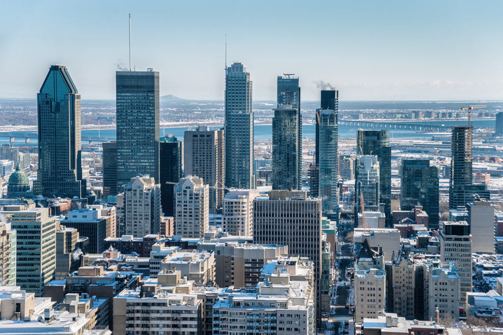 Montreal Skyline from Kondiaronk Belvedere / Mont-Royal. (Marc Bruxelle/Shutterstock) where to buy montreal real estate