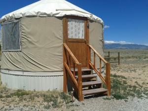 The yurt and the view outside: mountains, open spaces, pitch black at night with stars that freckled the sky.