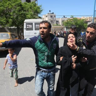 20160507_A-Gazan-women-reacts-after-her-children-are-killed-in-a-fire-in-Gaza