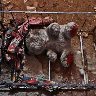 20160507_A-charred-burnt-baby-cot-after-blaze-in-gaza-home