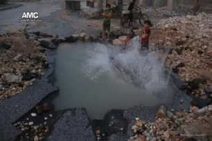 Syrian-children-swim-in-hole-on-street-left-by-airstrikes-3