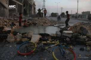 Syrian-children-swim-in-hole-on-street-left-by-airstrikes-4