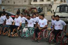 Imagen del maratón de discapacitados de Gaza celebrado en Gaza el 29 de noviembre de 2016 [Mohammed Asad / Monitor de Oriente]