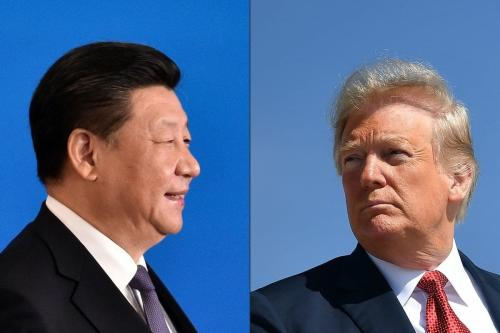 Presidente da China Xi Jinping e Presidente dos Estados Unidos Donald Trump [Iori Sagisawa, Mandel Ngan/AFP/Getty Images]