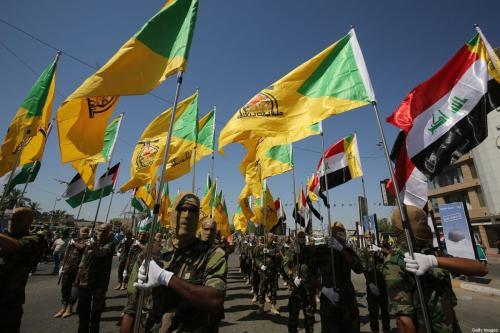 Brigadas do Hezbollah marcham em Bagdá, Iraque em 31 de maio de 2019 [Ahmad Al-Rubaye/ AFP / Getty Images]