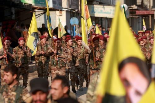 Polícia militar das Unidades de Proteção Popular do Curdistão (YPG), na Síria, 24 de fevereiro de 2018 [Delil Souleiman/AFP/Getty Images]