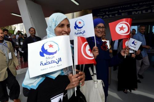 Apoiadores Ennahda durante abertura do congresso de três dias do partido islâmico, em Túnis, Tunísia, 20 de maio de 2016 [Fethi Belaid/AFP via Getty Images]