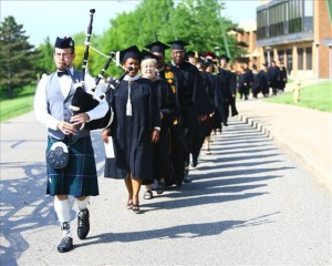 Pittsburgh Bagpiper Sean O'Donnell plays the bagpipes at a graduation ceremony