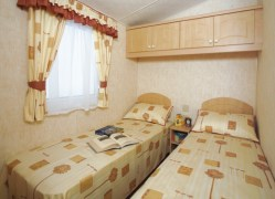 Towan Holiday Home twin bedroom at Monkey Tree Holiday Park near Newquay